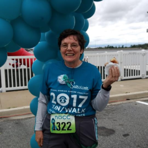Kathy is all smiles after the NOCC Ovarian Cancer Awareness 5K Run in Maryland (2017)